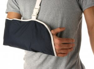 man with his arm in a sling after being injured in an accident