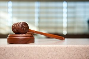 Wooden gavel, personal injury case